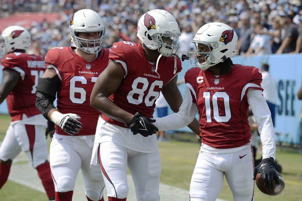 Arizona Cardinals wide receiver DeAndre Hopkins (10) is congratulated by Demetrius Harris (86) after Hopkins scored a touchdown against the Tennessee ...