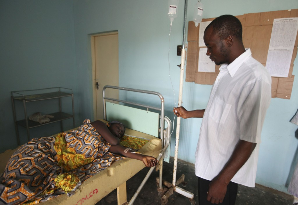 FILE - In this Monday, Sept. 6, 2010 file photo, a doctor treats a person suffering from cholera, at a village health clinic in Ganjuwa in Nigeria's r...
