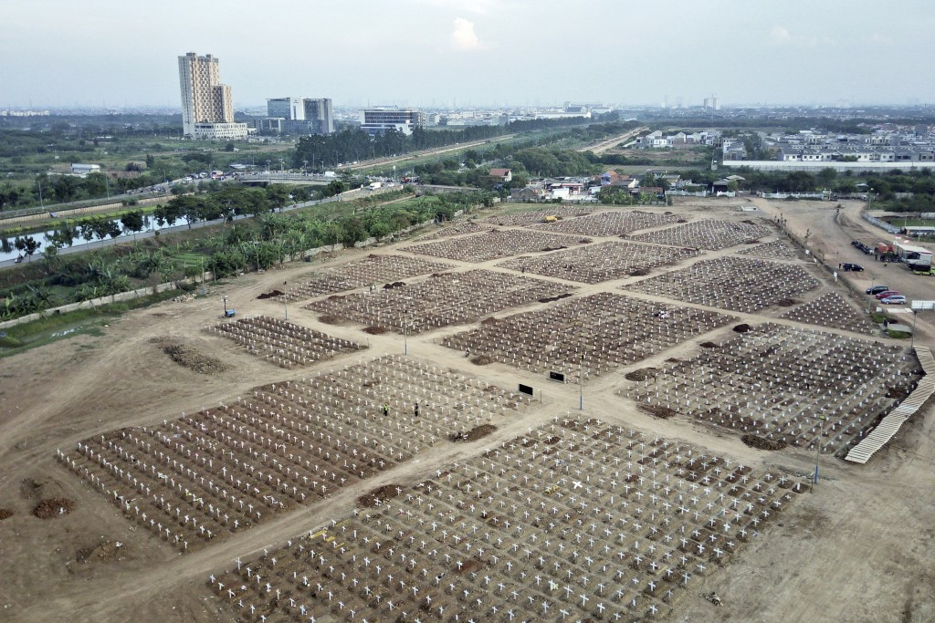 This photo taken using a drone shows an aerial view of Rorotan Cemetery which was reserved for those who died of COVID-19, in Jakarta, Indonesia, Wedn...
