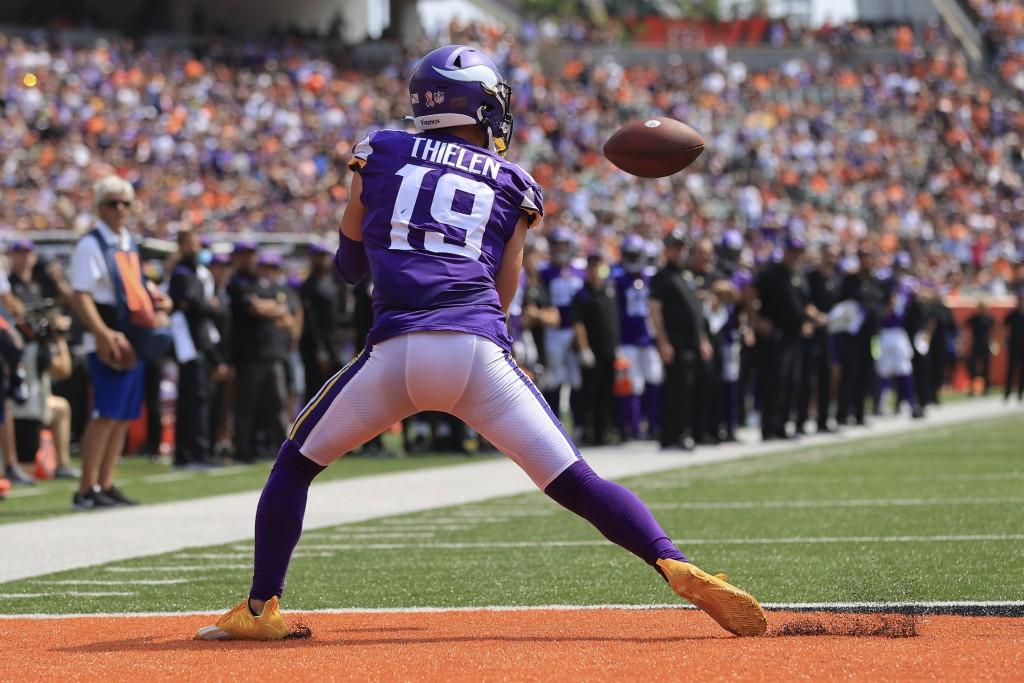 Minnesota Vikings wide receiver Adam Thielen (19) makes a catch for a touchdown against the Cincinnati Bengals in the first half of an NFL football ga...