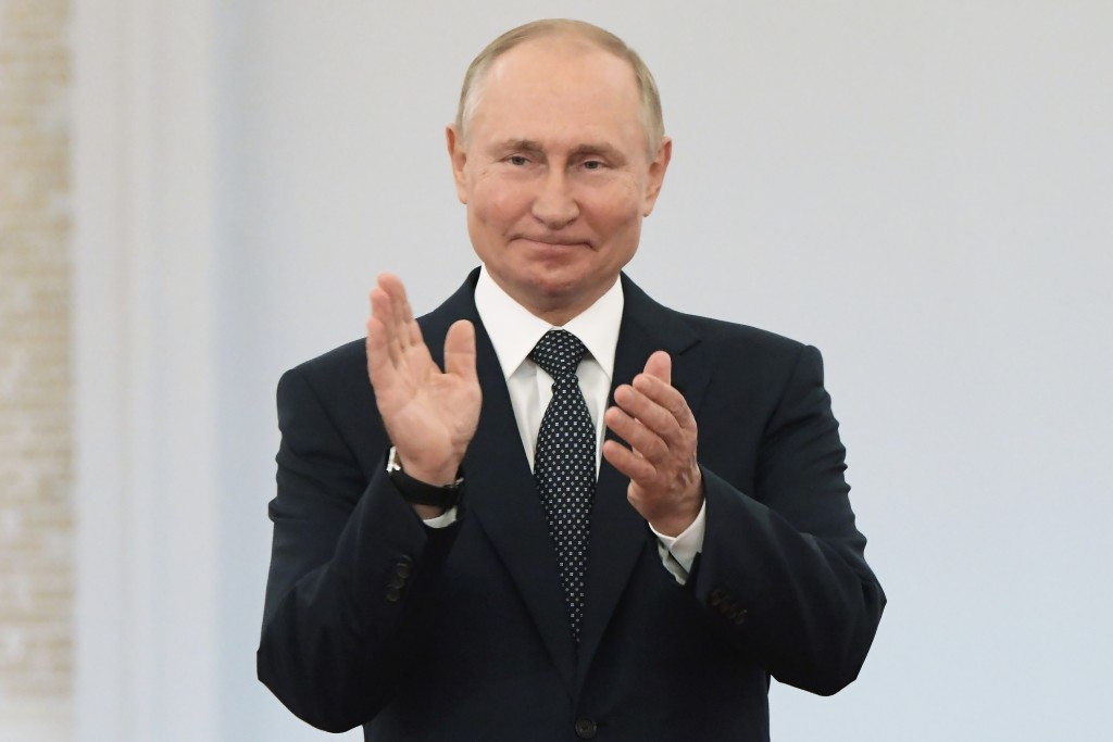 FILE - In this Saturday, Sept. 11, 2021 file photo, Russian President Vladimir Putin applauds during an awarding ceremony for the Russian Olympic Comm...