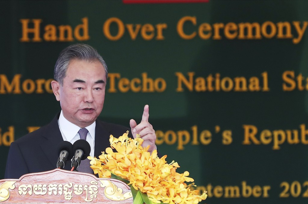 Chinese Foreign Minister Wang Yi delivers a speech during a ceremony to hand over the Morodok Techo National Stadium to the the Cambodian organizing c...