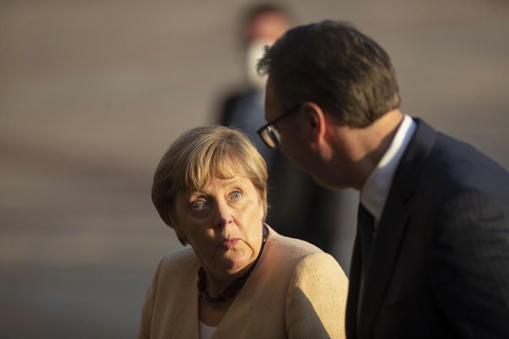 German Chancellor Angela Merkel, left, is accompanied by Serbia's president Aleksandar Vucic in Belgrade, Serbia, Monday, Sept. 13, 2021. Merkel is on...