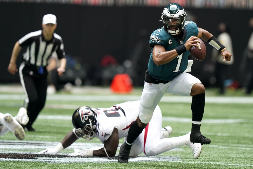 Philadelphia Eagles quarterback Jalen Hurts (1) breaks out of the pocket against the Atlanta Falcons during the first half of an NFL football game, Su...