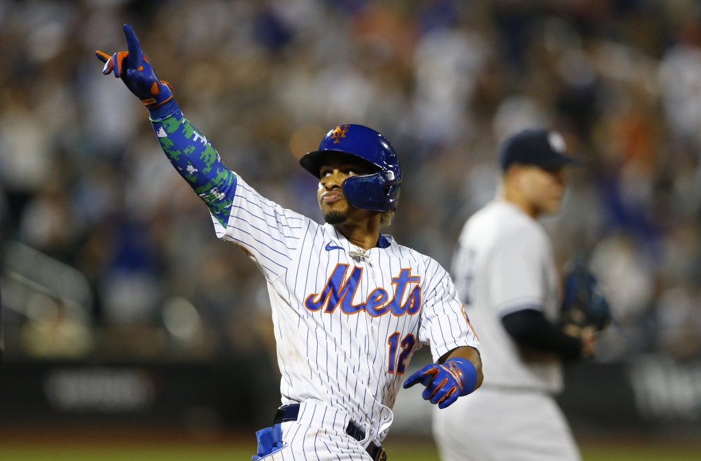 New York Mets' Francisco Lindor (12) reacts after his second home run in a baseball game against the New York Yankees in the sixth inning, Sunday, Sep...