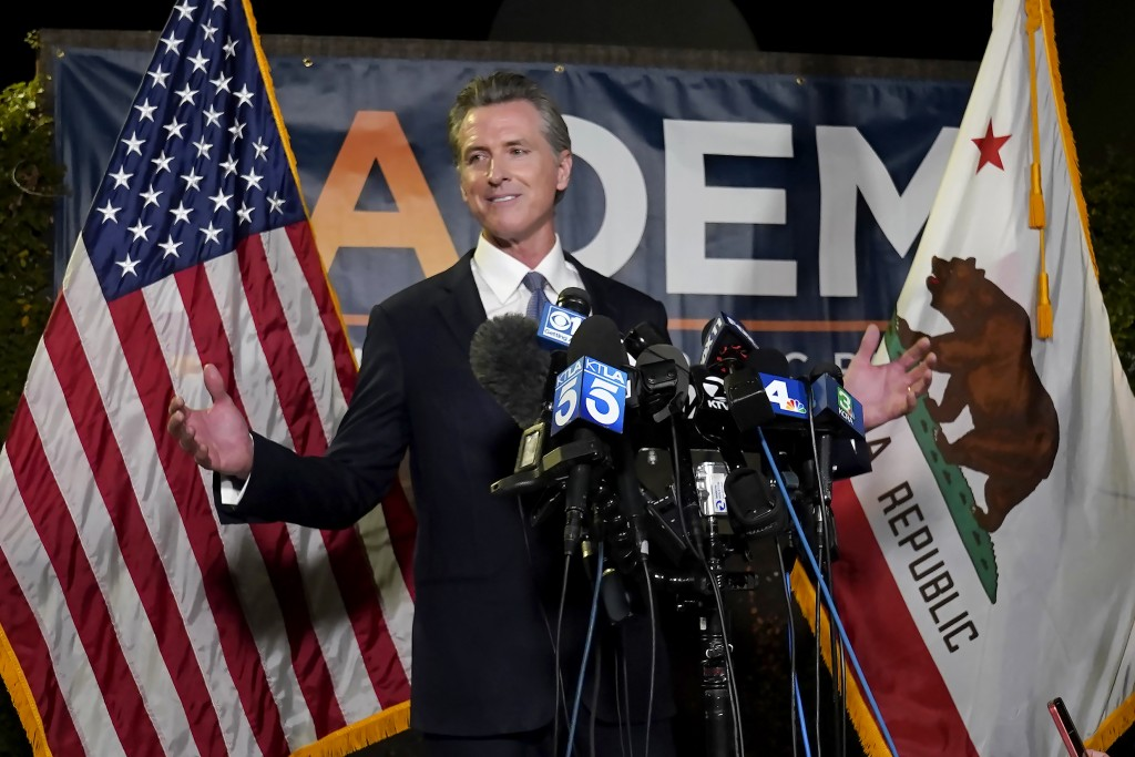 California Gov. Gavin Newsom addresses reporters after beating back the recall attempt that aimed to remove him from office, at the John L. Burton Cal...