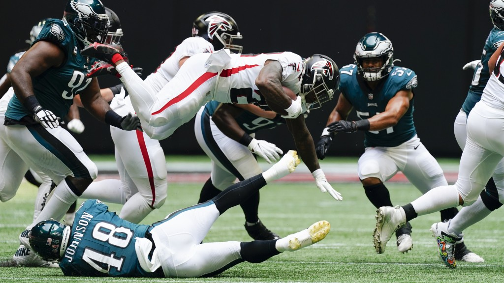 Atlanta Falcons running back Mike Davis (28) leaps in the air against the Philadelphia Eagles during the first half of an NFL football game, Sunday, S...