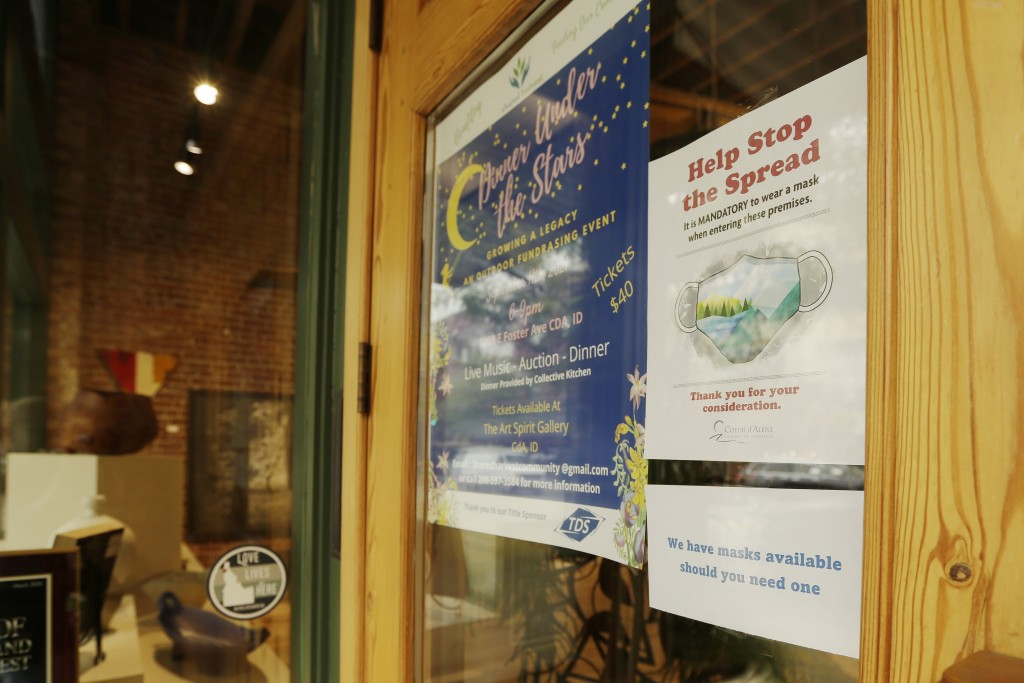 A mandatory mask usage sign is displayed at Art Spirit Gallery, Friday, Sept. 10, 2021, in Coeur d'Alene, Idaho.  Northern Idaho has a long and deep s...