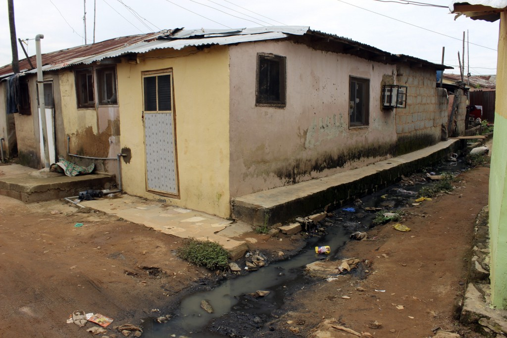 Sewage water runs past a house in Abuja, Nigeria, Friday, Sept. 3, 2021. Nigeria is seeing one of its worst cholera outbreaks in years, with more than...