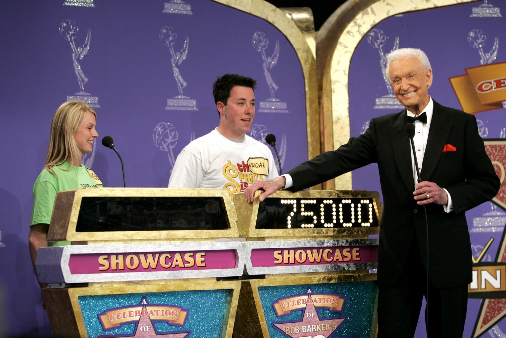 """FILE - Host Bob Barker appears with contestants during filming of a special prime-time episode of """"The Price Is Right,"""" in Los Angeles on April 17, 20..."""