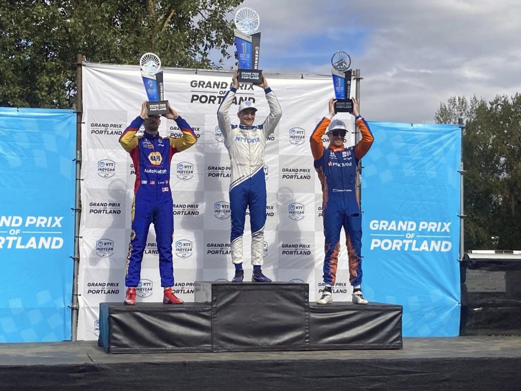 Alex Palou, center, celebrates his third IndyCar win of the season on Sunday, Sept. 12, 2021 at Portland International Raceway in Portland, Ore. Palou...