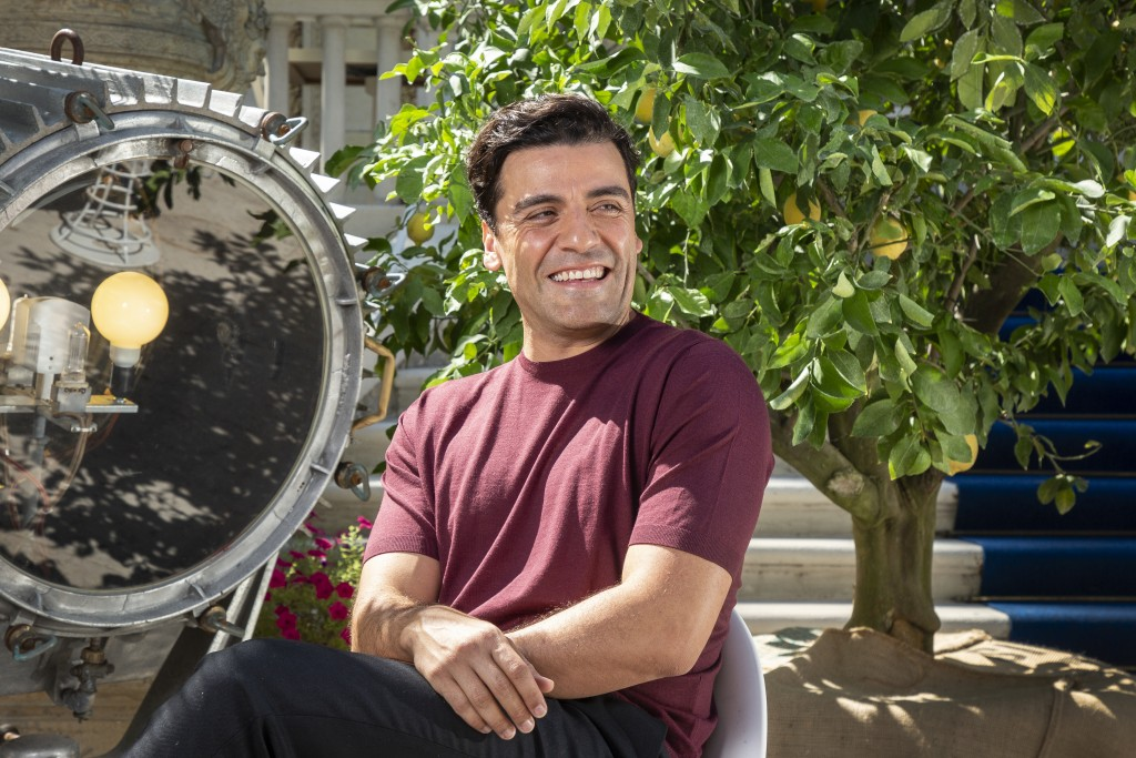 FILE - In this Sep, 2, 2021 file photo Oscar Isaac poses for portraits for the film 'The Card Counter' during the 78th edition of the Venice Film Fest...
