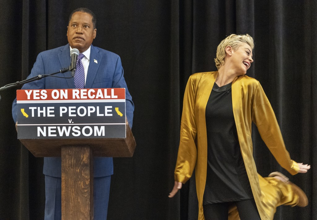 Republican conservative radio talk show host Larry Elder and former actor and activist Rose McGowan hold a news conference at the Luxe Hotel Sunset Bo...