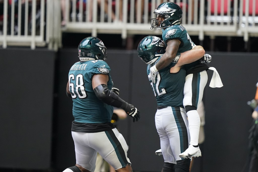 Philadelphia Eagles running back Kenneth Gainwell (14) celebrates his touchdown against the Atlanta Falcons during the second half of an NFL football ...