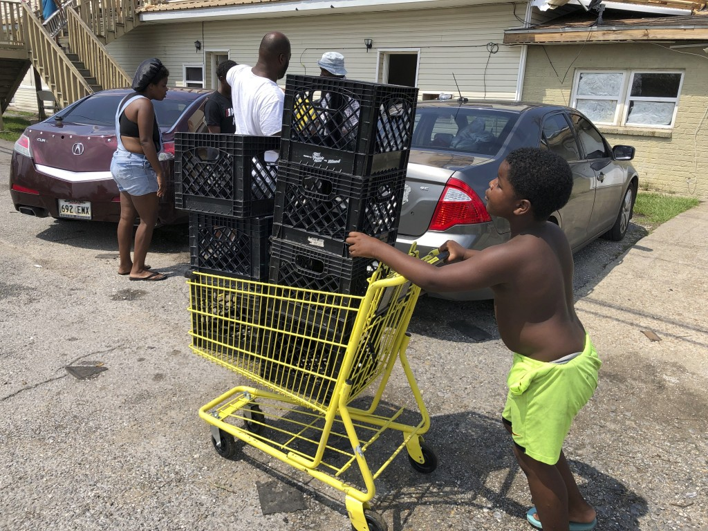 Christopher Williams, 5, pushes a shopping cart outside his family's destroyed apartment in Luling, La., on Tuesday, Sept. 7, 2021. Williams, and his ...