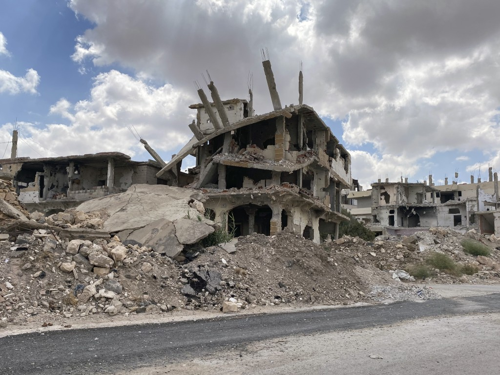 Buildings damaged by Syrian government forces following clashes with rebel fighters are seen in the southern city of Daraa, Syria, Sunday, Sept 12, 20...