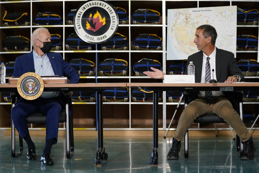 President Joe Biden listens to Grant Beebe, Assistant Director for Fire and Aviation at the Bureau of Land Management during a visit to the National I...