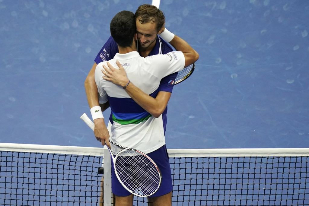 Daniil Medvedev, of Russia, right, hugs Novak Djokovic, of Serbia, after defeating Djokovic during the men's singles final of the US Open tennis champ...
