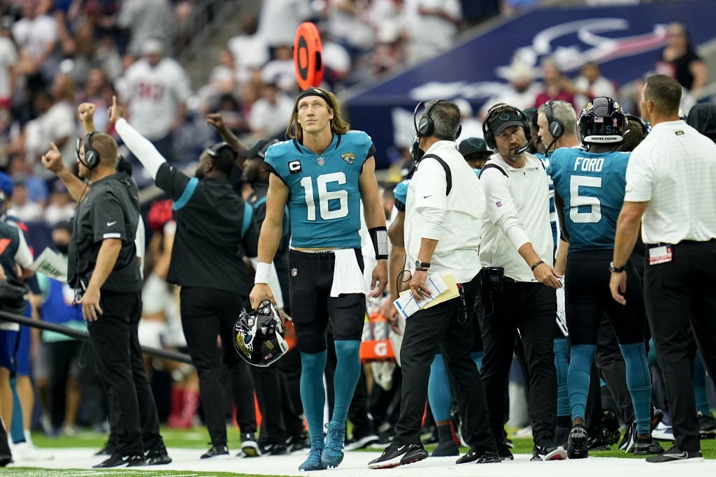 Jacksonville Jaguars quarterback Trevor Lawrence (16) walks back to the bench after throwing an interception against the Houston Texans during the sec...