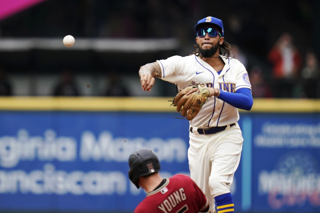 Seattle Mariners shortstop J.P. Crawford, top, throws to first base after forcing out Arizona Diamondbacks' Andrew Young, bottom, at second base in th...
