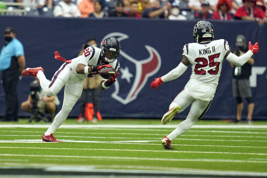Houston Texans safety Justin Reid (20) intercepts a pass against the Jacksonville Jaguars during the first half of an NFL football game Sunday, Sept. ...