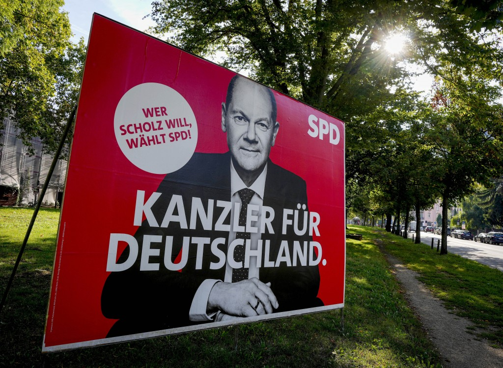 An election poster shows Social Democratic top candidate for chancellor Olaf Scholz in Frankfurt, Germany, Monday, Sept. 13, 2021. German elections wi...