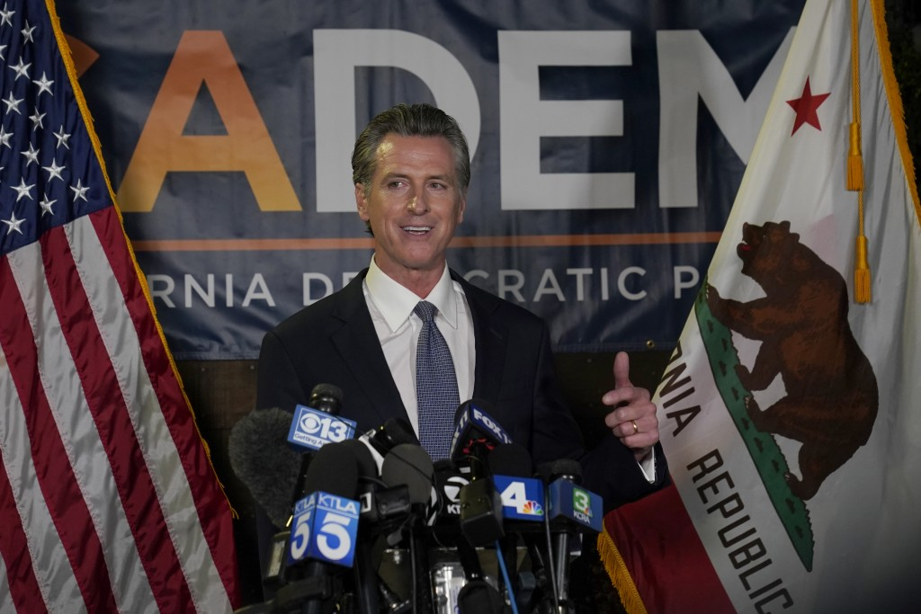 California Gov. Gavin Newsom addresses reporters, after beating back the recall attempt that aimed to remove him from office, at the John L. Burton Ca...