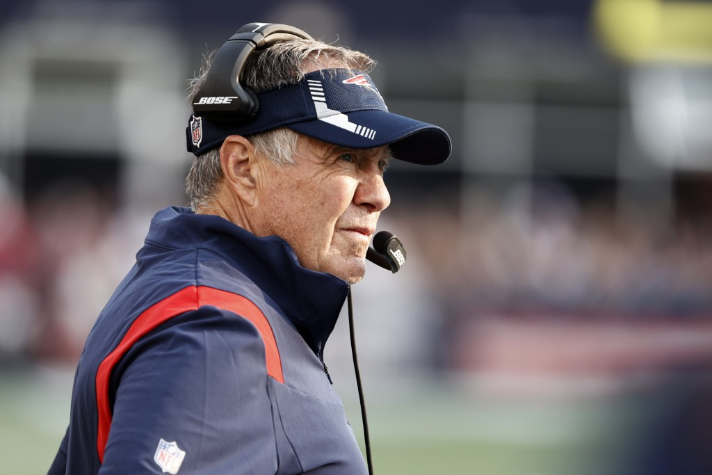 New England Patriots head coach Bill Belichick watches play during the first half of an NFL football game against the Miami Dolphins, Sunday, Sept. 12...