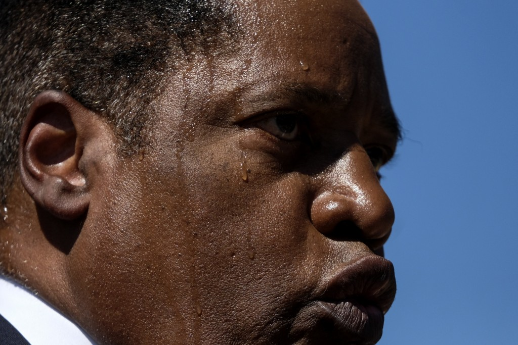 Sweat beads up on Republican conservative radio show host Larry Elder's face as he speaks at a rally for the California gubernatorial recall election ...