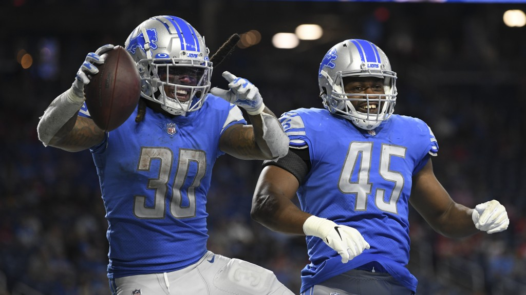 Detroit Lions running back Jamaal Williams (30) celebrates his touchdown run with Jason Cabinda (45) in the second half of an NFL football game agains...