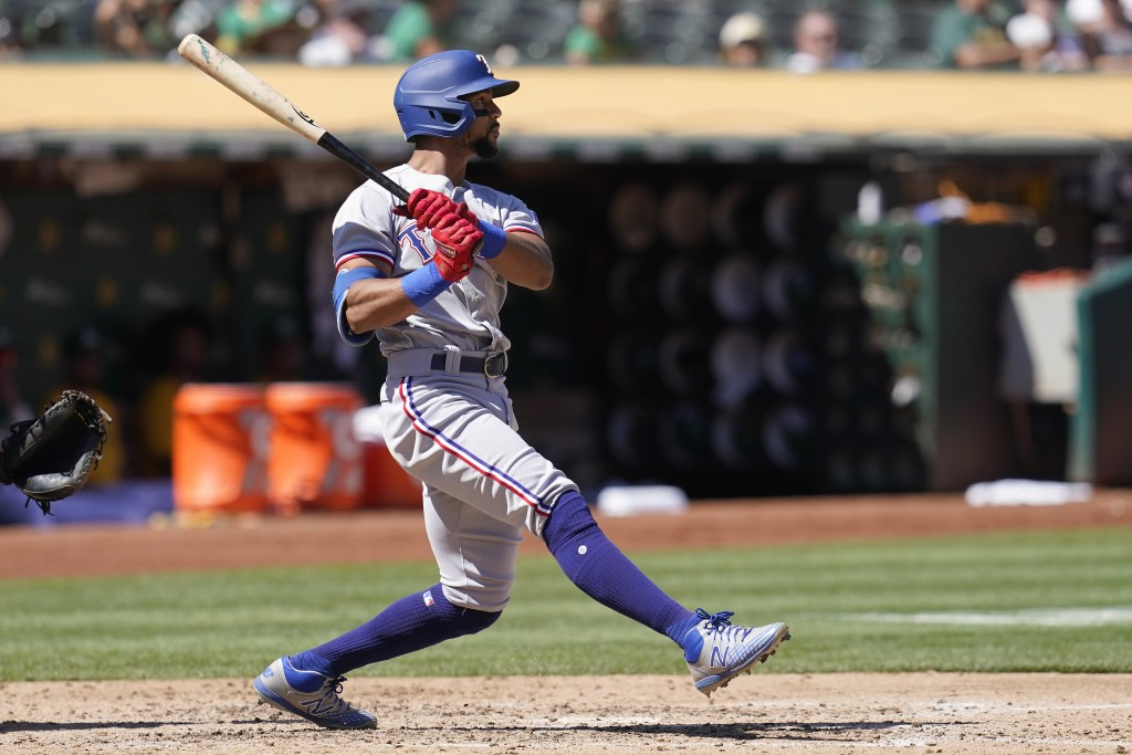 Texas Rangers' Leody Taveras hits an RBI-triple against the Oakland Athletics during the fourth inning of a baseball game in Oakland, Calif., Sunday, ...