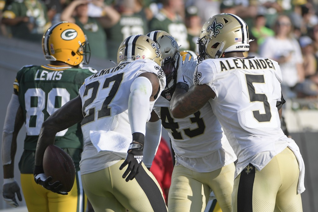 New Orleans Saints middle linebacker Kwon Alexander (5) and strong safety Malcolm Jenkins (27) congratulate free safety Marcus Williams (43) after he ...
