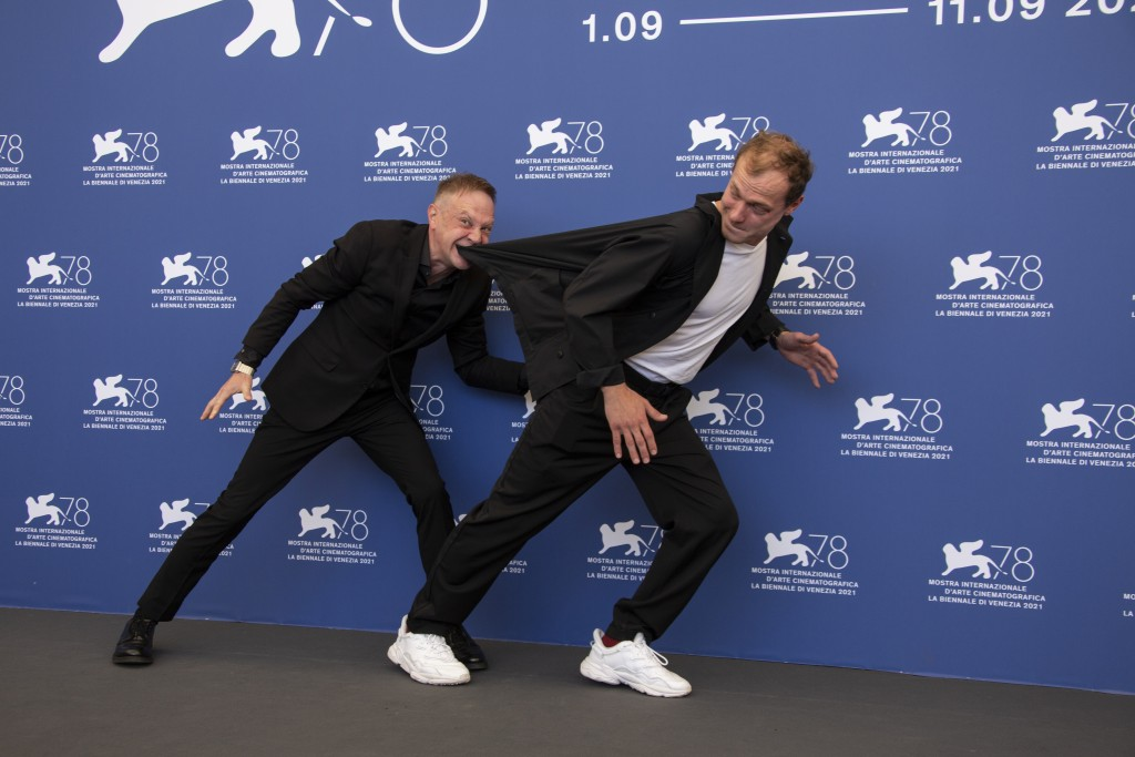 FILE - In this Sept, 8, 2021 file photo Timofey Tribuntsev, left, and Yuriy Borisov pose for photographers at the photo call for the film 'Kapitan Vol...