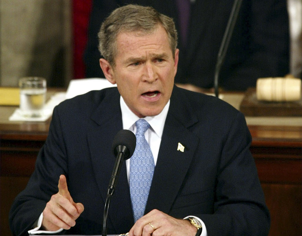 """FILE - In this Jan. 29. 2002, file photo, President George W. Bush labels North Korea, Iran and Iraq an """"axis of evil"""" during his State of the Union a..."""