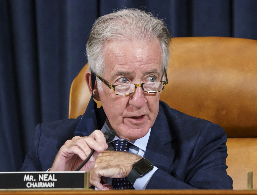 In this Sept. 9, 2021 photo, House Ways and Means Committee Chairman Richard Neal, D-Mass., presides over a markup hearing to craft the Democrats' Bui...