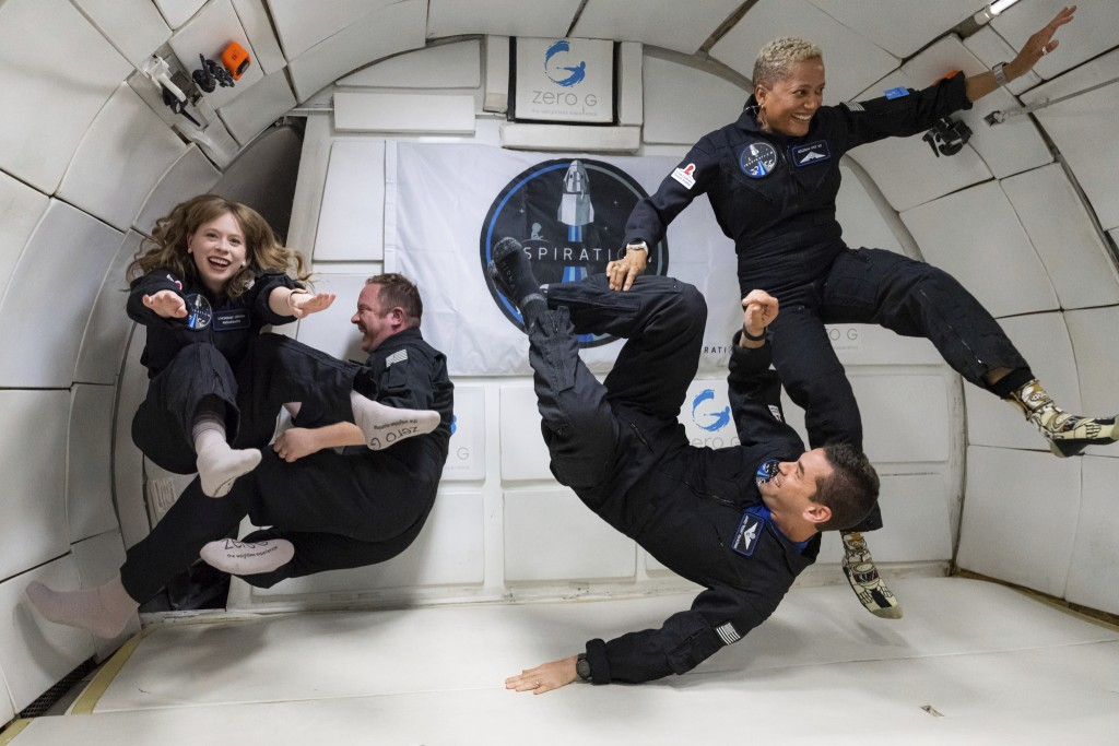 In this July 11, 2021 photo provided by John Kraus, from left, Hayley Arceneaux, Chris Sembroski, Jared Isaacman and Sian Proctor float during a zero ...