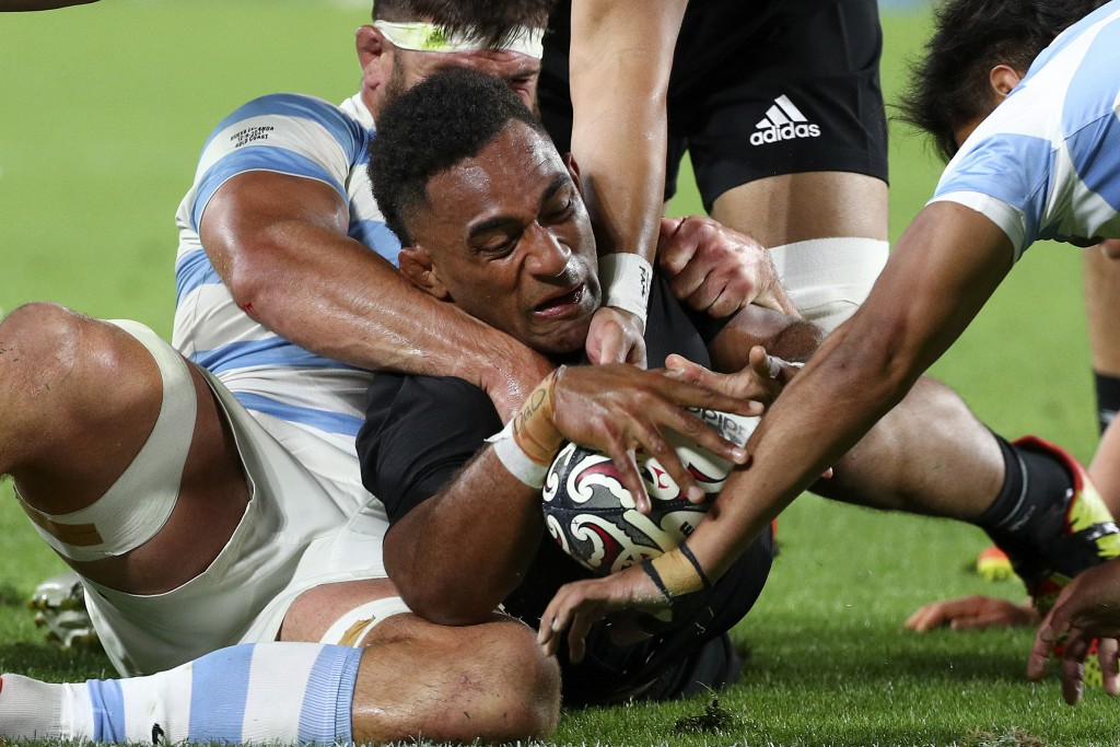 New Zealand's Sevu Reece, center, has his try attempt spoiled by the Argentine defense during their Rugby Championship match on Sunday, Sept. 12, 2021...