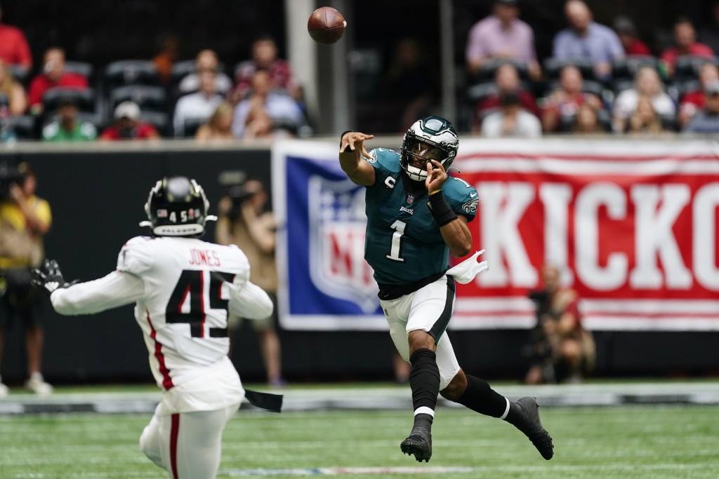 Philadelphia Eagles quarterback Jalen Hurts (1) throws the ball as Atlanta Falcons linebacker Deion Jones (45) defends during the first half of an NFL...