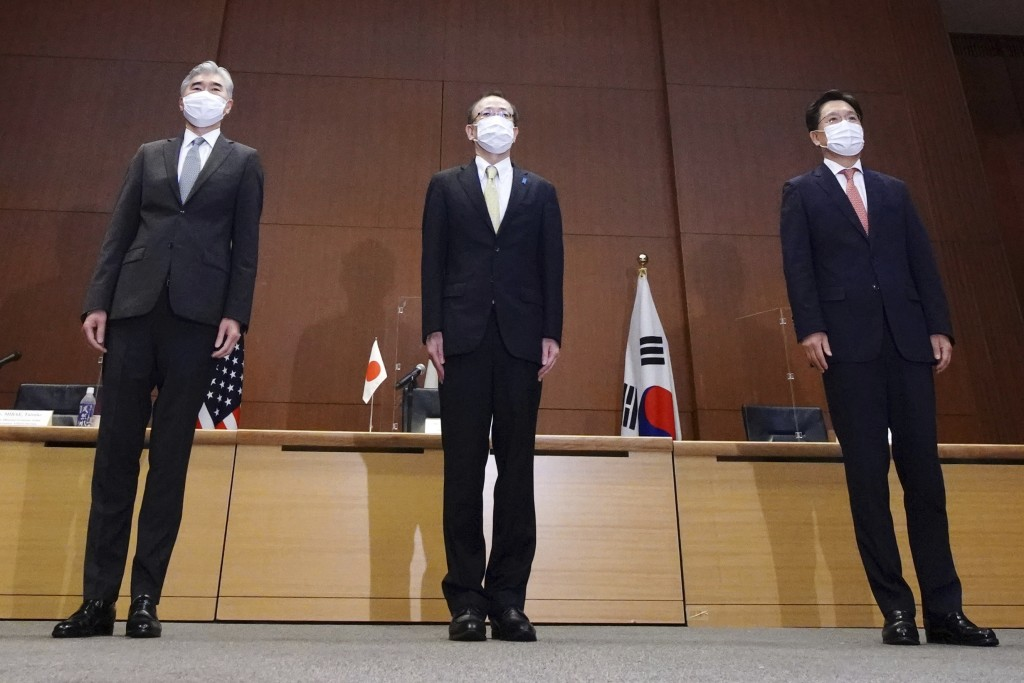 Japanese Foreign Ministry's Director-General of the Asian and Oceanian Affairs Bureau Takehiro Funakoshi, center, U.S. Special Representative for Nort...