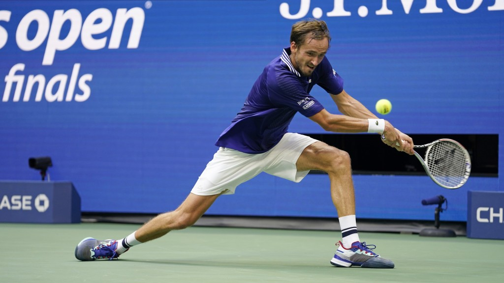 Daniil Medvedev, of Russia, returns a shot to Novak Djokovic, of Serbia, during the men's singles final of the US Open tennis championships, Sunday, S...