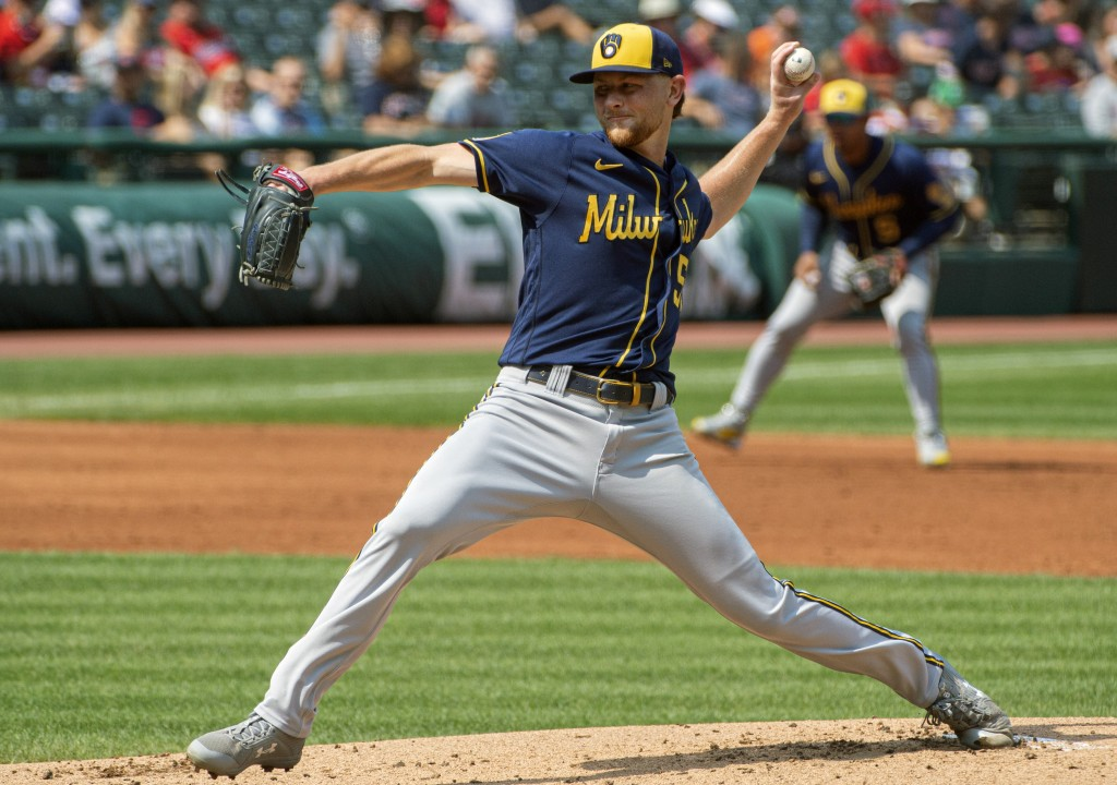 Milwaukee Brewers starting pitcher Eric Lauer delivers against the Cleveland Indians during the second inning of a baseball game in Cleveland, Sunday,...