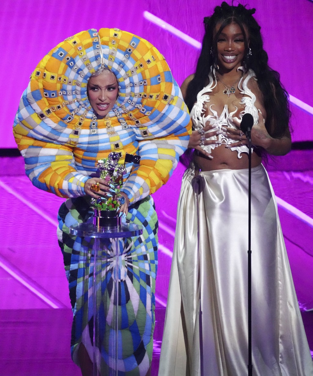 """Doja Cat, left, and SZA accept the award for best collaboration for """"Kiss Me More"""" at the MTV Video Music Awards at Barclays Center on Sunday, Sept. 1..."""