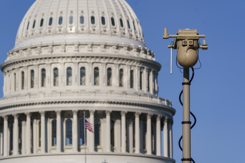 FILE - In this Sept. 10, 2021, file photo a video surveillance apparatus is seen on the East Front of the Capitol in Washington as security officials ...