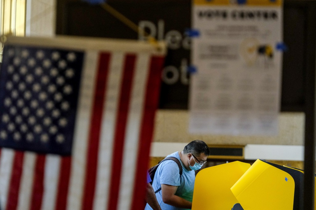 A voter casts a ballot for the California recall election at a vote center at Union Station, Tuesday, Sept. 14, 2021, in Los Angeles. (AP Photo/Ringo ...