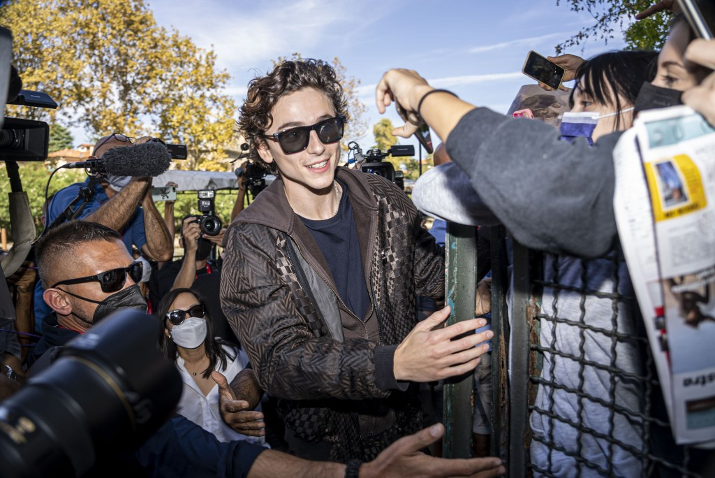 FILE - In this Sept, 3, 2021 file photo Timothee Chalamet meets fans upon arrival for the photo call of the film 'Dune' at the 78th edition of the Ven...