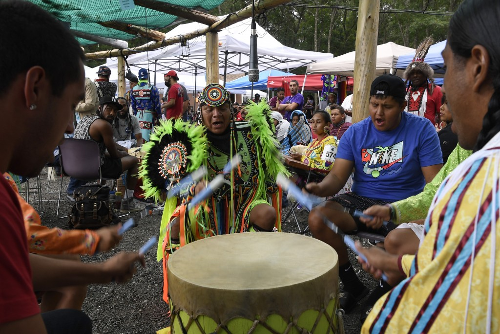 **HOLD FOR STORY BY SUSAN HAIGH** Drum group Ho-Chunk Station from Wisconsin perform during Schemitzun at the Mashantucket Pequot Tribal Nation, in Ma...