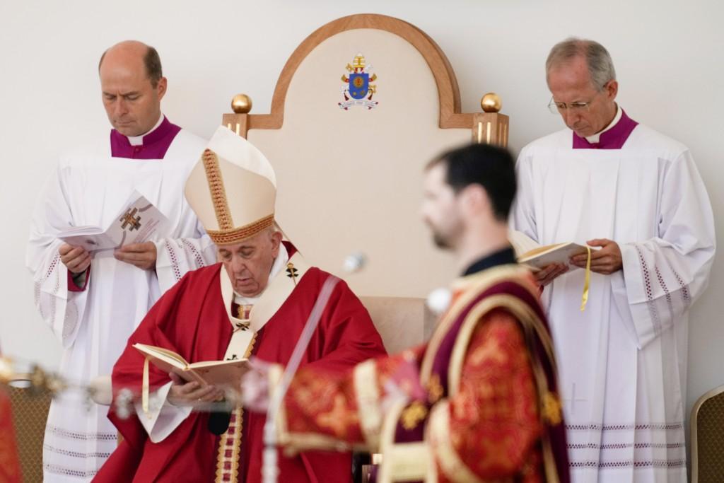 Pope Francis, center, attends a Byzantine rite Mass at Mestska sportova hala Square, in Presov, Slovakia, Tuesday, Sept. 14, 2021. Pope Francis is on ...