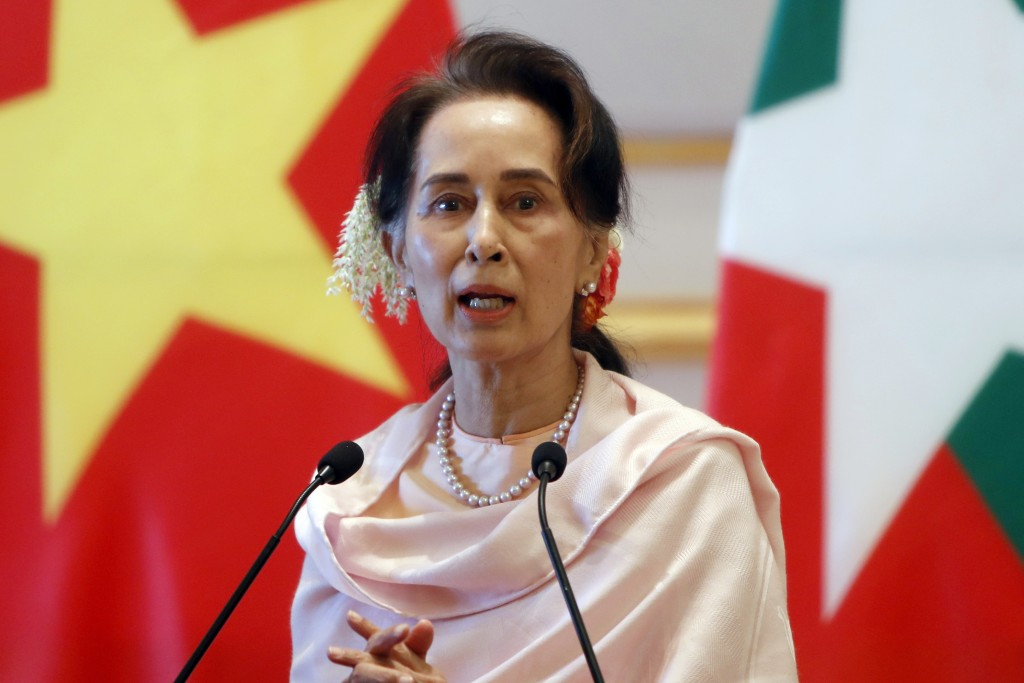 FILE - In this Dec. 17, 2019, file photo, Myanmar's former leader Aung San Suu Kyi speaks during a joint press conference with Vietnam's Prime Ministe...