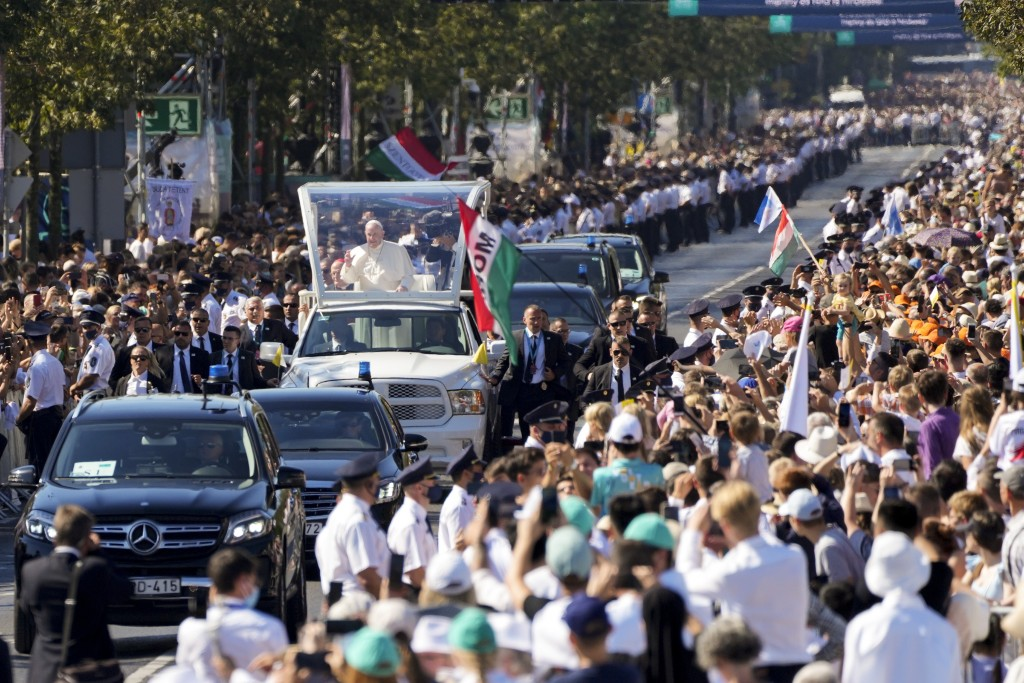 Pope Francis arrives on his popemobile to celebrate mass for the closing of the International Eucharistic Congress, at Budapest's Heroes Square, Sunda...