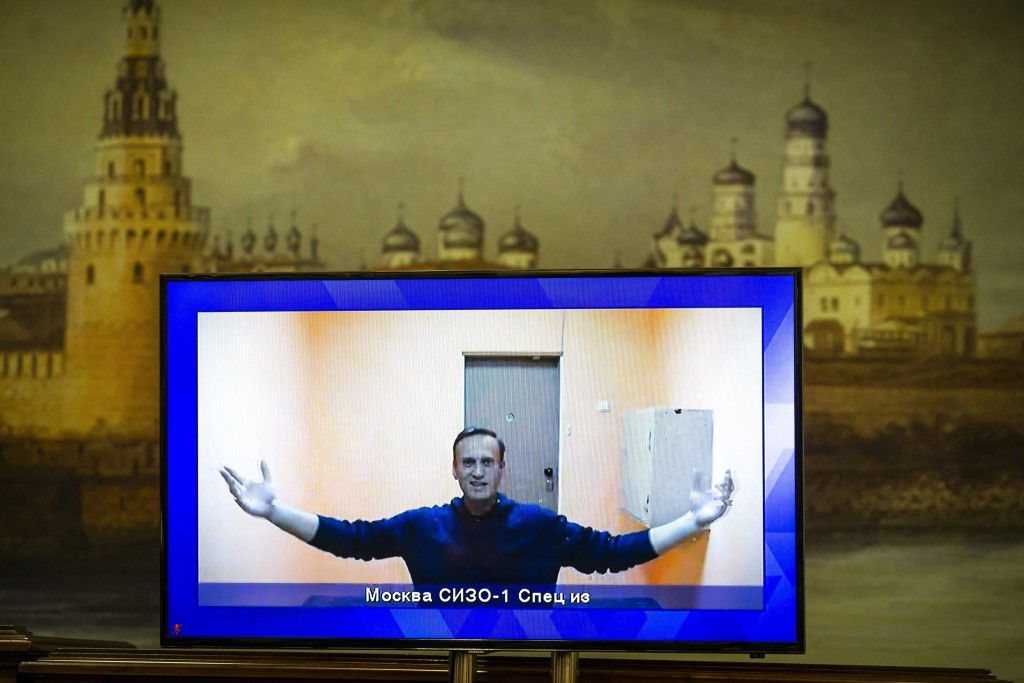 FILE - In this Jan. 28, 2021, file photo, Russian opposition leader Alexei Navalny appears on a TV screen during a court hearing appealing his jailing...